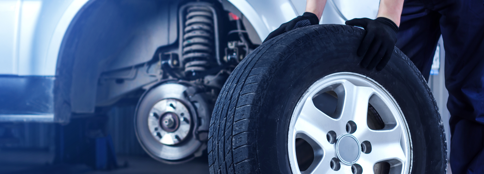 Image of a mechanic holding a tyre - Order Car Tyres Online Kings Langley